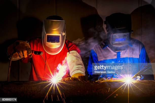 worker at the factory welding - fabricage apparatuur stock pictures, royalty-free photos & images