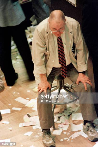 Worker at the New York Stock Exchange takes a break after closing bell 28 October 1987 The Dow Jones Industrial Average closed at 184682 up 33 points...