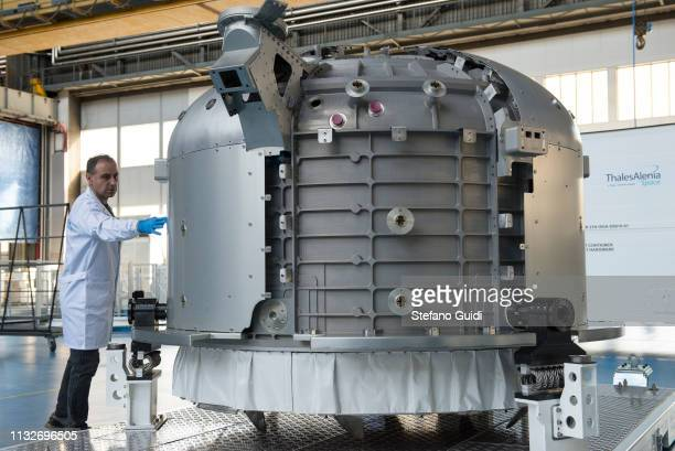 A worker at work on the Airlock commercial space envelope during the press presentation for the International Space Station at Thales Alenia Space...