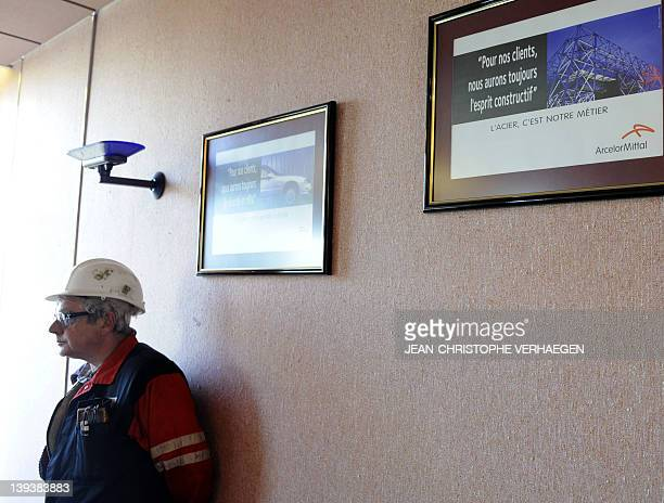 A worker attends the occupation of a meeting room at the world's largest steel maker Arcelor Mittal plant of Florange eastern France on February 20...