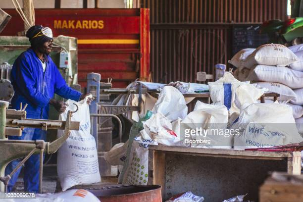 A worker bags up livestock feed into sacks ready for shipping on the Ehlerskroon farm outside Delmas in the Mpumalanga province South Africa on...