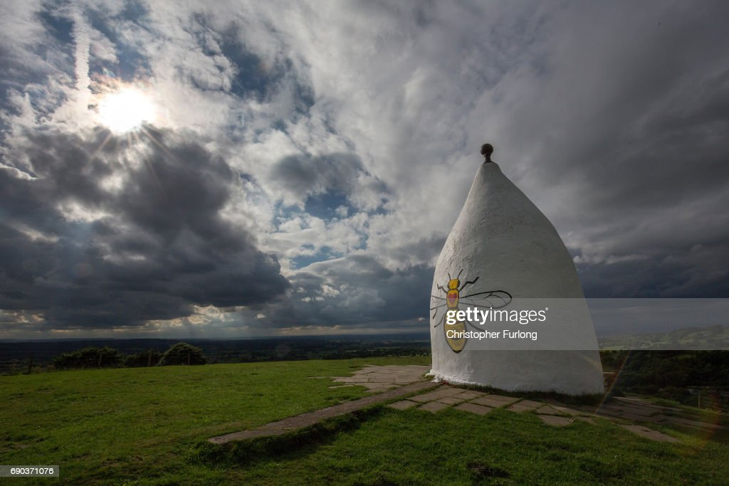 A worker bee adorns the side of Bollington White Nancy to remember those killed and injured in the Manchester Arena attack, on May 30, 2017 in Macclesfield, England. White Nancy overlooks the hills and countryside in East Chesire with views across the plain to Manchester and can be seen for miles. White Nancy was built in 1815 as a summer house, and memorial to the the battle of Waterloo. An explosion occurred at Manchester Arena on the evening of May 22, Killing 22 and injuring many more.