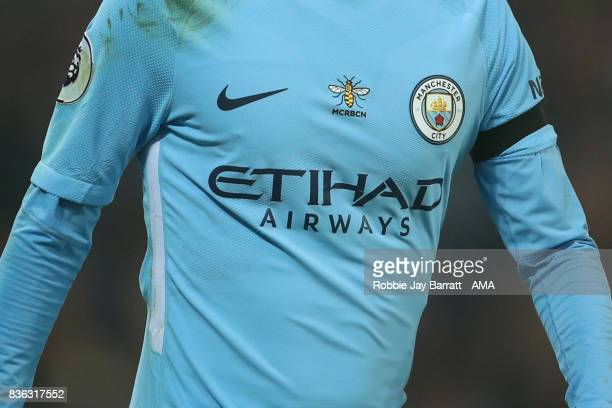 Worker Bee on a Manchester City shirt which has been modified for the game to reflect the attack on Manchester Arena in May and in Barcelona and...