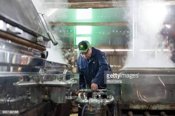 A worker boils maple tree sap through evaporators at the Wagler Maple Products processing facility in Wessesley Ontario Canada on Friday March 2 2018...