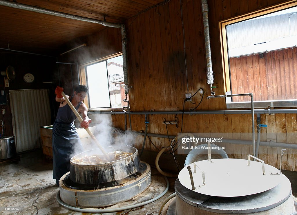 A worker boils the bark of mulberry wood at a mill that produces handmade paper at Iwano Heizaburo Seishi Sho Company in Echizen paper village on July 4, 2011 in Fukui, Japan. Washi paper is a tough paper, used for traditional Japanese arts such as Origami and Shodo, most commonly made from bark of the mulberry, gampi or mitsumata. The paper milling process is a traditional craft of the Echizen people dating back 1500 years which continues today along with modern paper manufacturing. Echizen city is home to many paper businesses, as well as the cultural museum of paper and papyrus centre where visitors can make their own paper.