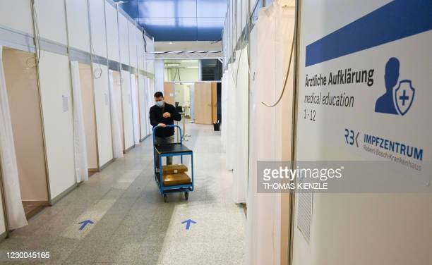 Worker brings technical equipment into booths of the corona vaccination center at the Robert Bosch hospital in Stuttgart, southern Germany, on...