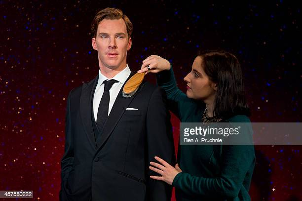 A worker brushes off a new wax figure of Benedict Cumberbatch at Madame Tussauds on October 21 2014 in London England