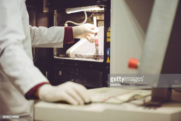 worker brushing powder off 3d powder printer - 3d printing stock pictures, royalty-free photos & images