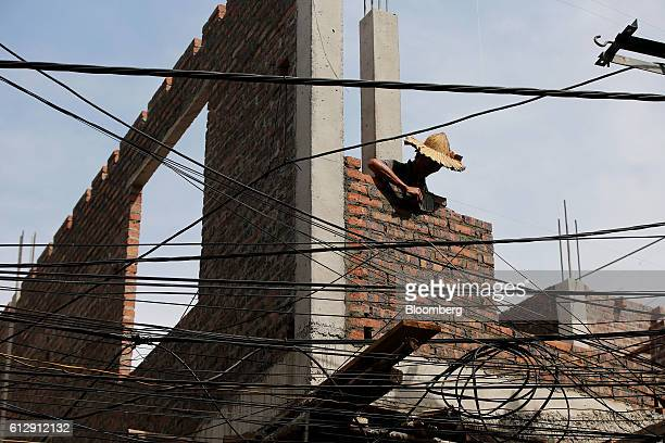 A worker builds the wall of a building under construction in Ap Don hamlet Bac Ninh Province Vietnam on Thursday Sept 1 2016 Samsung Electronics Co...