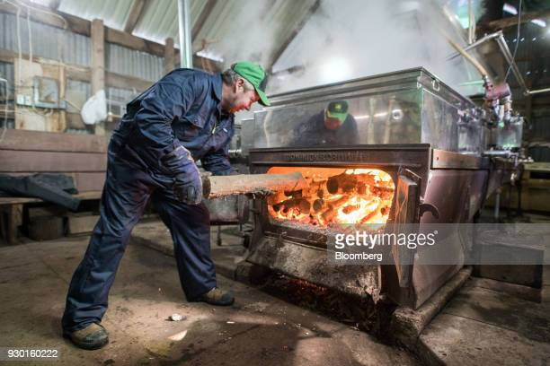 A worker burns wood in evaporators used to boil maple tree sap at the Wagler Maple Products processing facility in Wessesley Ontario Canada on Friday...
