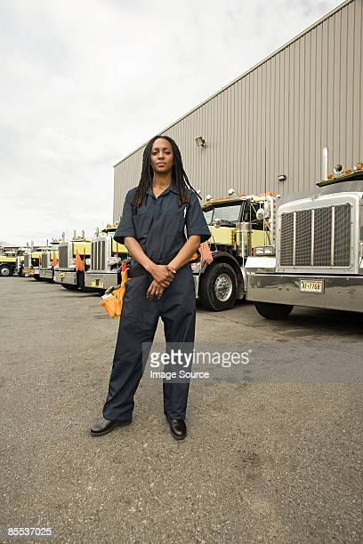 worker by trucks - bib overalls stock pictures, royalty-free photos & images