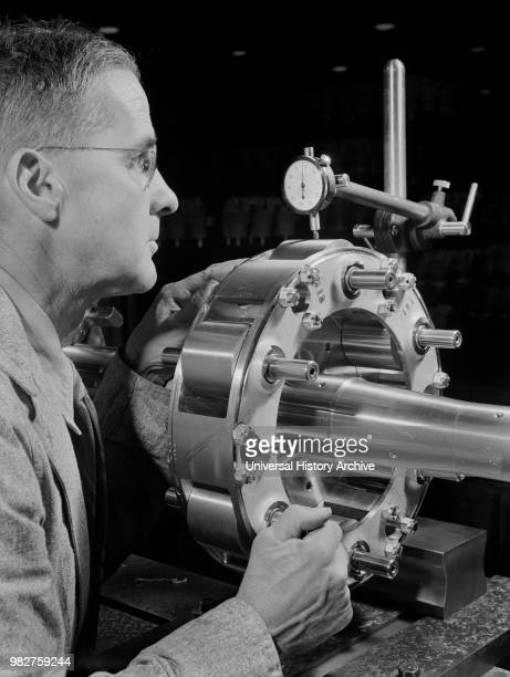Worker Carefully Checking an Airplane Propeller Shaft for Concentricity at Manufacturing Plant Pratt Whitney East Hartford Connecticut USA Andreas...