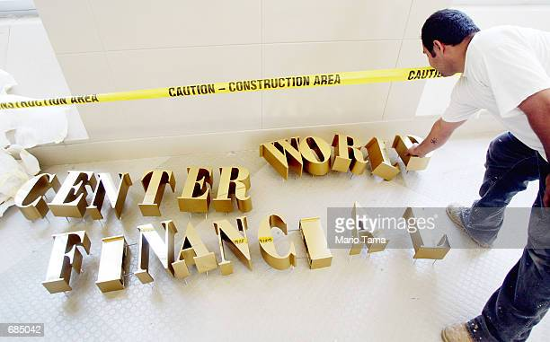 Worker Carlos Lodas prepares lettering for the World Financial Center June 10 2002 in New York City The building is being rebuilt after the Sept 11...