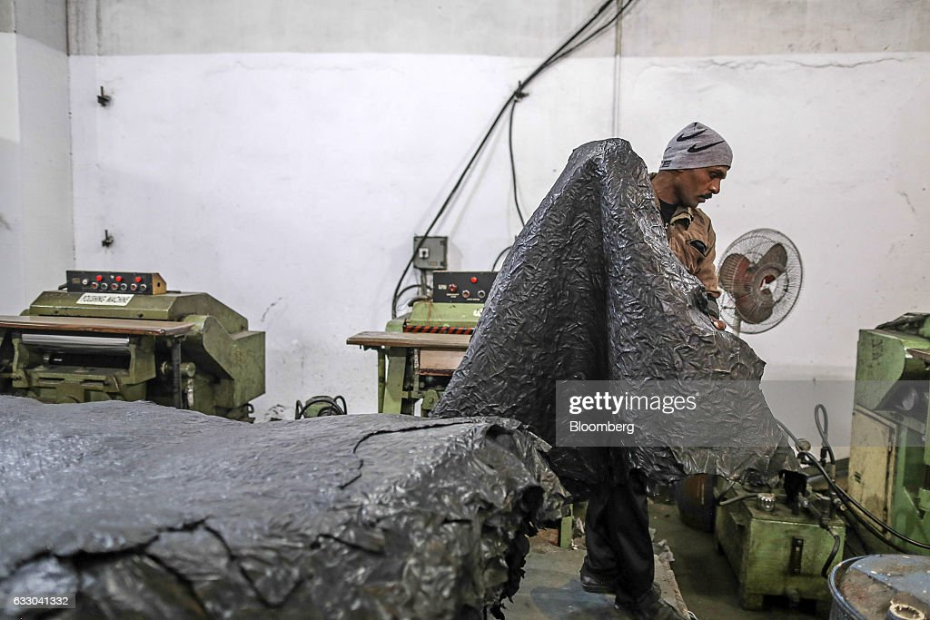A worker carries a sheet of dyed leather at the Jalandhar Leather Pvt tannery in Jalandhar Punjab India on Saturday Jan 21 2017 India`s 51 million...