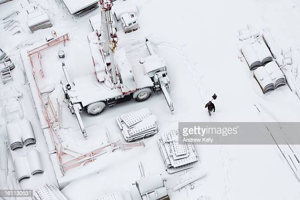 A worker carries a snow shovel across the Ground Zero consturction sight following a major winter storm on February 9 2013 in New York City New York...