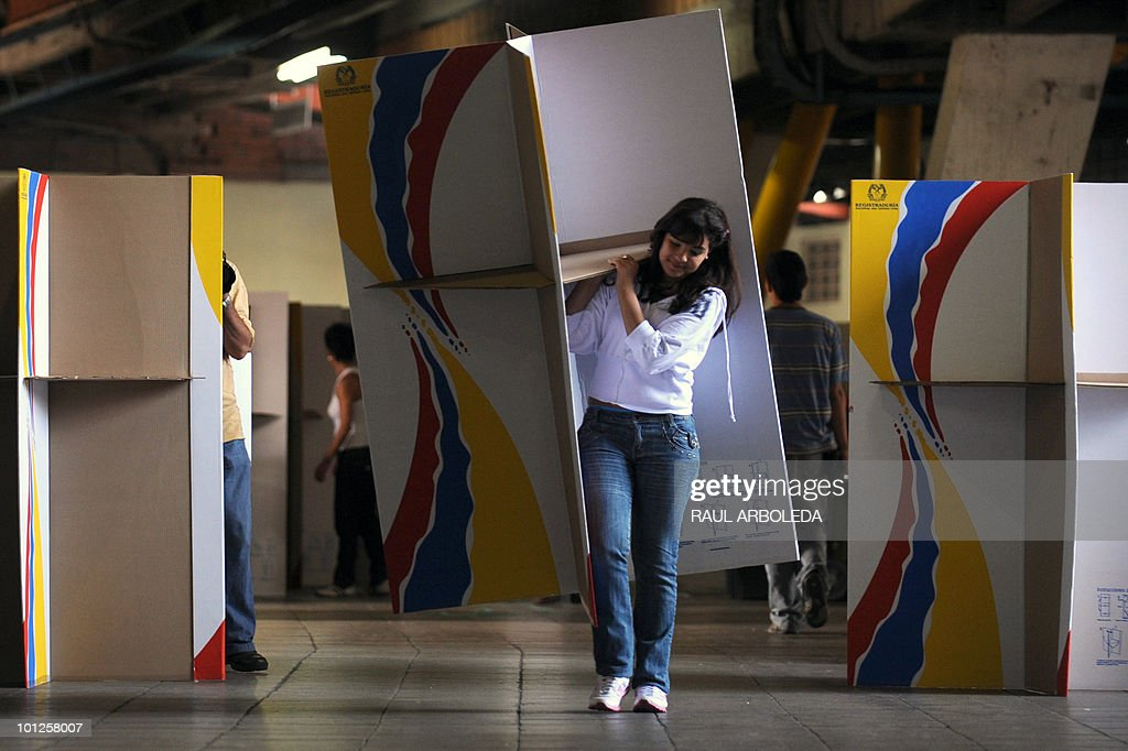 A worker carries a voting booth at a polling center in Medelllin, Antioquia department, Colombia on May 29, 2010. Colombia will hold presidential elections next May 30, and according to polls, a run-off election between Antanas Mockus for the Green Party and Juan Manuel Santos for the ruling National Unity Party, will take place on June 20. AFP PHOTO/ Raul ARBOLEDA