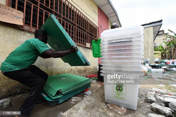A worker carries electoral materials at the Independent National Electoral Commission central office in Port Harcourt Rivers State on March 8 2019...