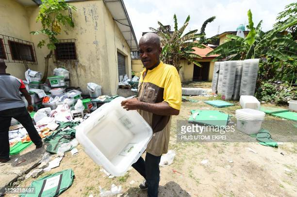 A worker carries empty ballot boxes at the Independent National Electoral Commission central office in Port Harcourt Rivers State on March 8 2019...