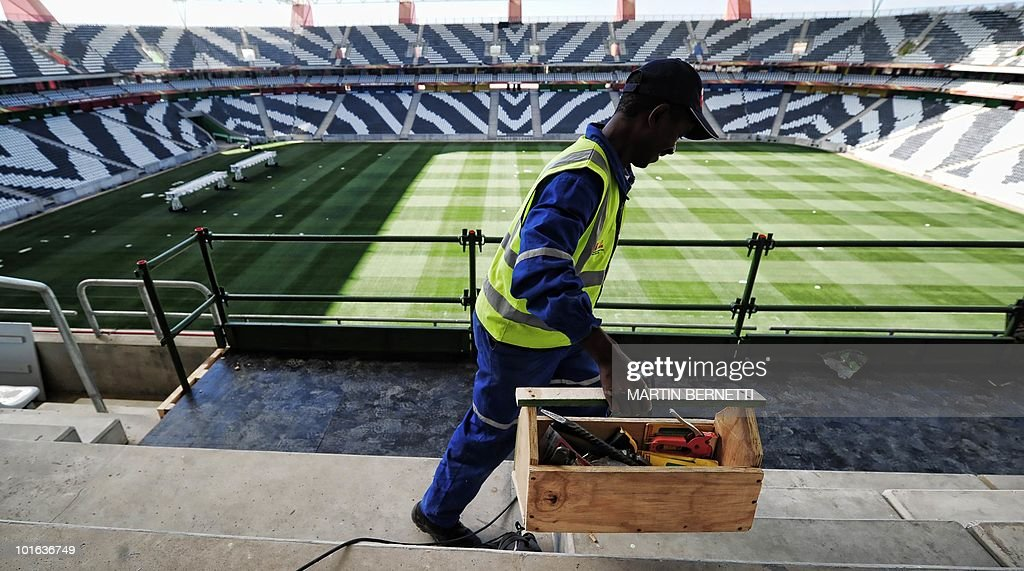 A worker carries his tools box at the Mbombela Stadium in Nelspruit on June 5, 2010. Chile and Honduras will play their first match of the 2010 Fifa World Cup here on June 16. AFP PHOTO / Martin BERNETTI