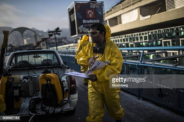A worker carries notes documenting the fumigation process at the Sambadrome ahead of Carnival celebrations in Rio de Janeiro Brazil on Tuesday Jan 26...