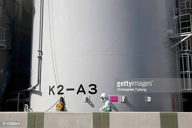 A worker carries out work on new radiation contaminated water tanks at Fukushima Daiichi nuclear power plant on February 24 2016 in Okuma Japan Five...