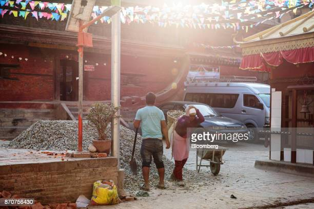 A worker carries rocks in a basket on her back in Lalitpur Kathmandu Valley Nepal on Wednesday Nov 1 2017 India and China have often jostled for...