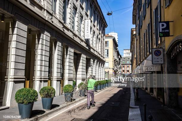 A pedestrian passes the Gianni Versace SpA headquarters in Milan Italy on Monday Sept 24 2018 Handbag maker Michael Kors Holding Ltd is nearing an...