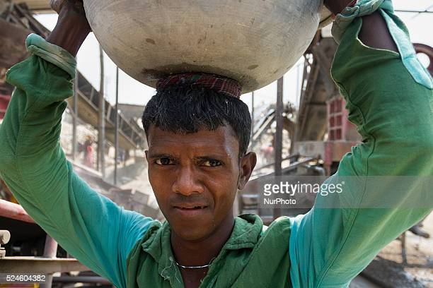 A worker carrying stone to put those in crashing machine in a Stone Crashing Plant in Sylhet Bangladesh A huge percentage of stone is being supplied...