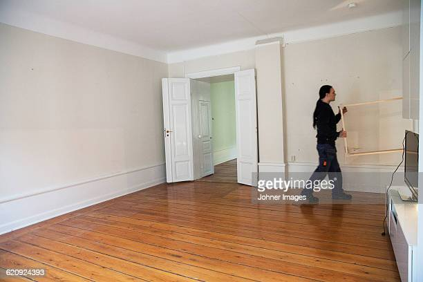 Worker carrying table into apartment