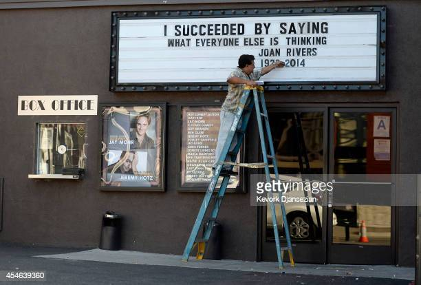 A worker changes the marquee of the Improv comedy club to display a quote from the late comedian Joan Rivers on September 4 2014 in Los Angeles...