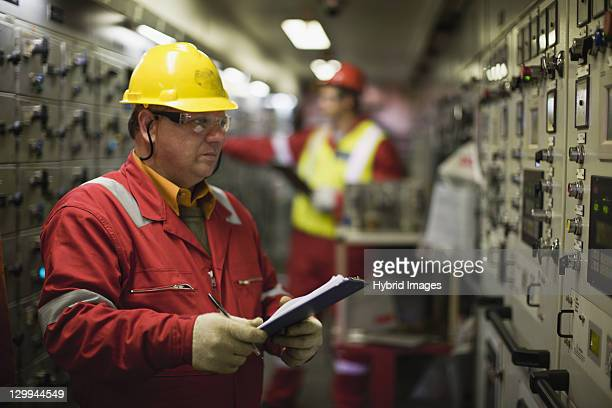 worker checking machinery - power occupation stock photos and pictures