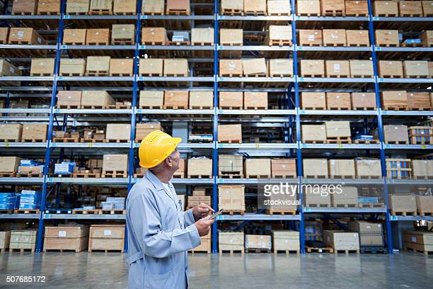 Worker checking the storages in warehouse