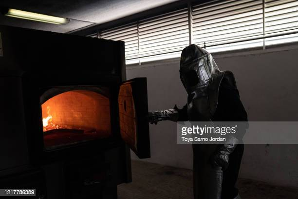 A worker checks a cremation oven as the number of deaths continues to rise due to the COVID19 pandemic on June 5 2020 at the Panteón Municipal in...