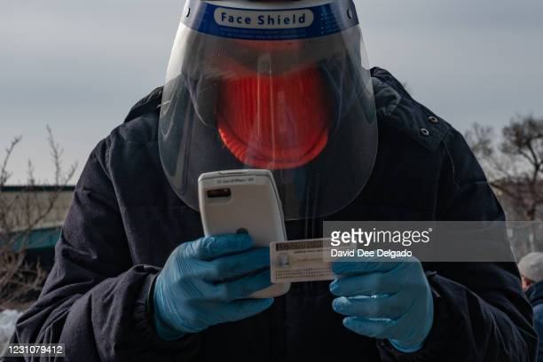 Worker checks in a person for the vaccine at the coronavirus vaccination site at Citi Field on February 10, 2021 in the Queens borough of New York...
