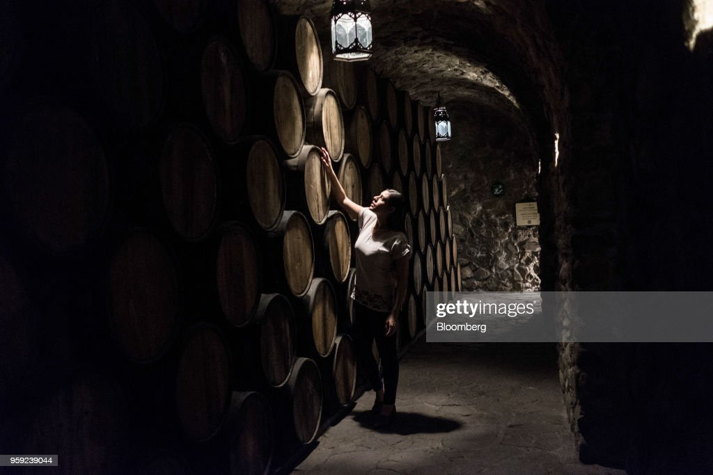 A worker checks on barrels of tequila at the Becle SAB Jose Cuervo distillery in the town of Tequila, Jalisco state, Mexico, on Thursday, May 3, 2018. Jose Cuervo sales are benefiting from the trend toward premium spirits, with solid volume and higher average prices driving mid- to high-single-digit top-line growth.Photographer: Mauricio Palos/Bloomberg via Getty Images