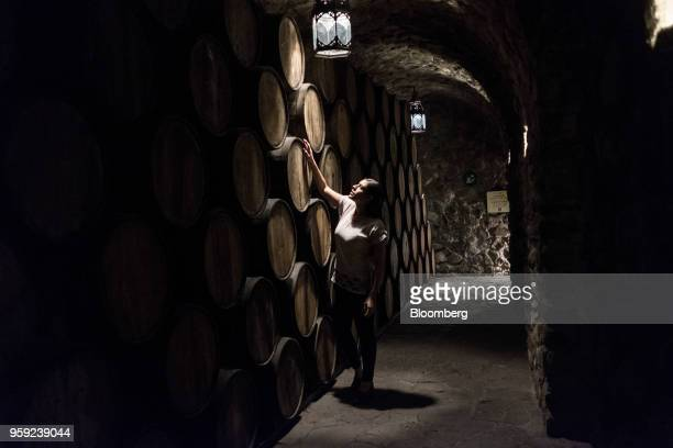 A worker checks on barrels of tequila at the Becle SAB Jose Cuervo distillery in the town of Tequila Jalisco state Mexico on Thursday May 3 2018 Jose...