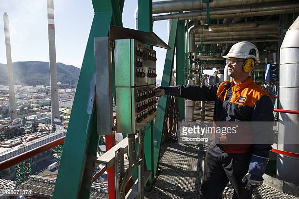 A worker checks pressure levels in a petroleum cracking tower at the Repsol SA oil refinery in Cartagena Spain on Tuesday Nov 24 2015 Since the...