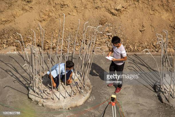 A worker checks reinforcing steel on concrete foundations near the Luang Prabang railway bridge a section of the ChinaLaos Railway built by the China...