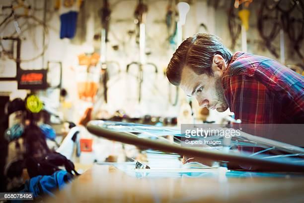 Worker checks tablet at bike shop