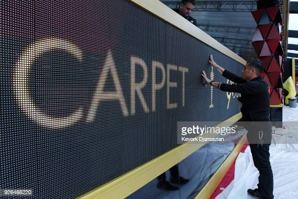 A worker checks the LED ticker display board on the red carpet during preparations for the 90th Academy Awards on March 2 2018 in Hollywood California
