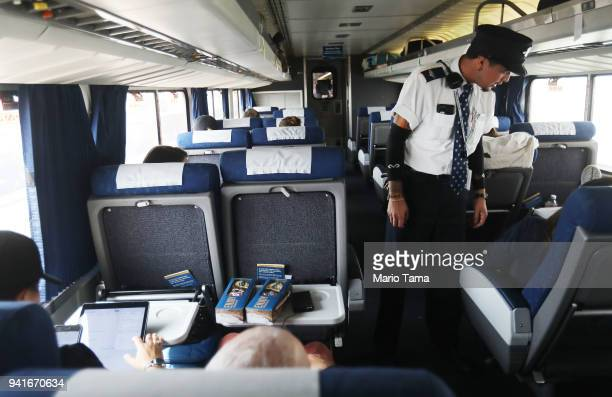 A worker checks with passengers on an Amtrak train on April 3 2018 in Los Angeles California Between 2016 and 2017 public transit ridership fell in...