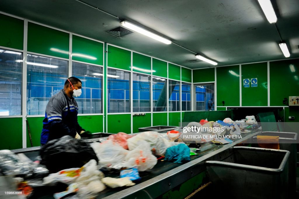 A worker classifies garbage for recycling at Valorsul, a waste treatment plant, in Lisbon on January 22, 2013.