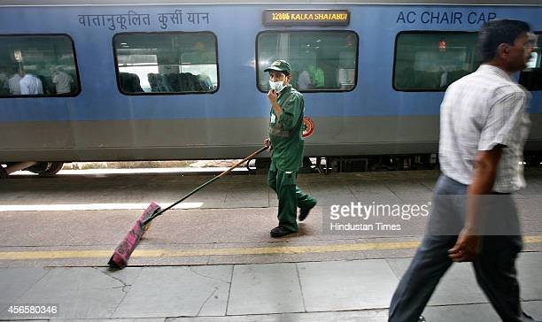Worker clean railway platform as part of Clean India Drive at Railway Station on October 2 2014 in New Delhi India Prime Minister Narendra Modi...