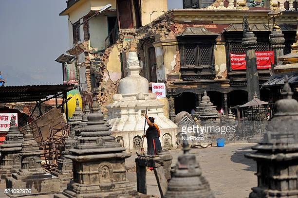 Worker cleaning around Swayambhunath Stupa on April 25, 2016. Most of monuments, old houses were badly destroyed by last year's earthquake on April...