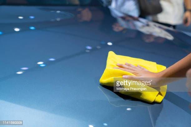 worker cleaning car - microfiber towel stock photos and pictures