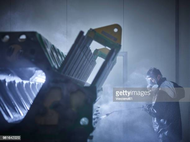 worker cleaning engine block in washing bay - high pressure cleaning stock pictures, royalty-free photos & images