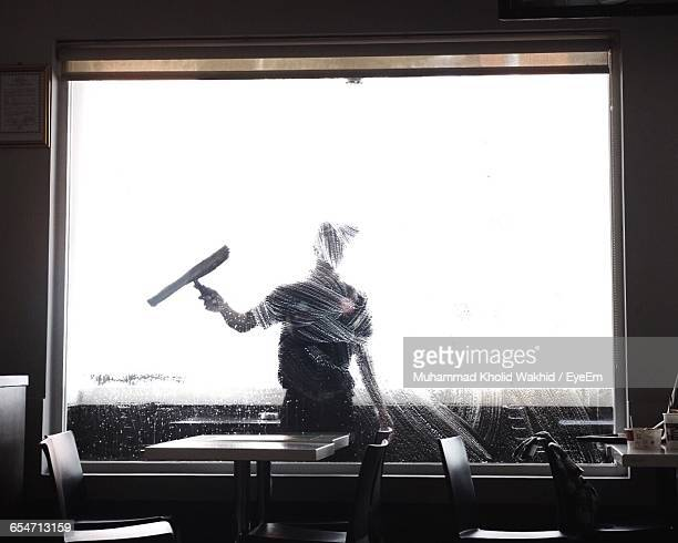 Worker Cleaning Glass Window