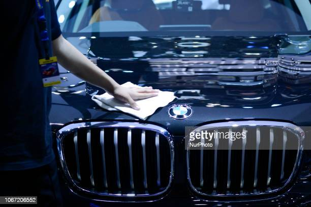 A worker cleans a BMW at Thailand International Motor Expo 2018 at Muang Thong Thani in Bangkok Thailand 01 December 2018