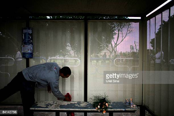 A worker cleans a bus station where Irit Shitrit mother of 4 was killed by a Hamas rocket strike yesterday on December 30 2008 in Ashdod about 30 KM...