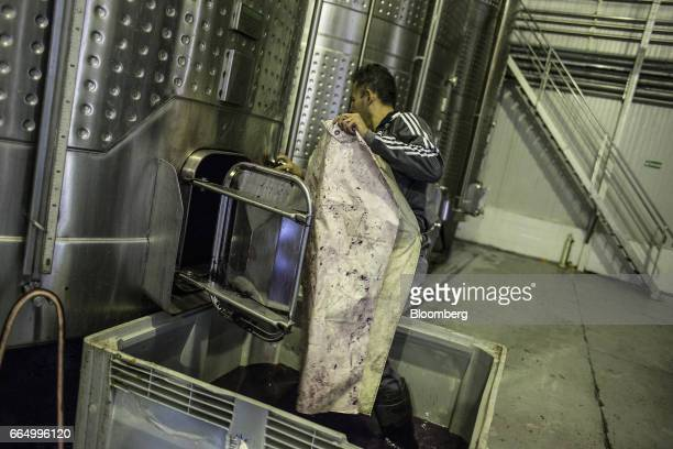 A worker cleans a fermentation tank at the Bodega Santa Julia production facility in Mendoza Argentina on Tuesday March 23 2017 The Argentine wine...